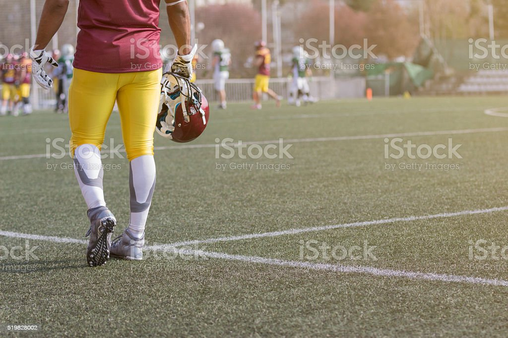 American football sportsman player holding helmet stock photo