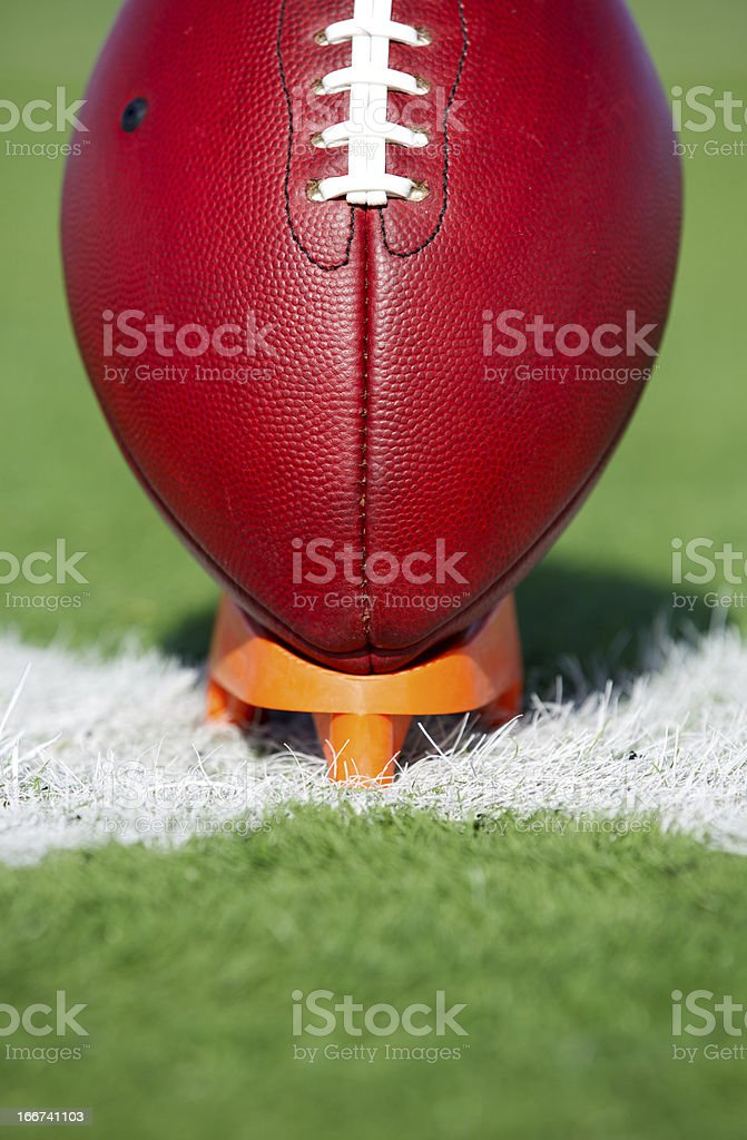American Football teed up for kickoff royalty-free stock photo