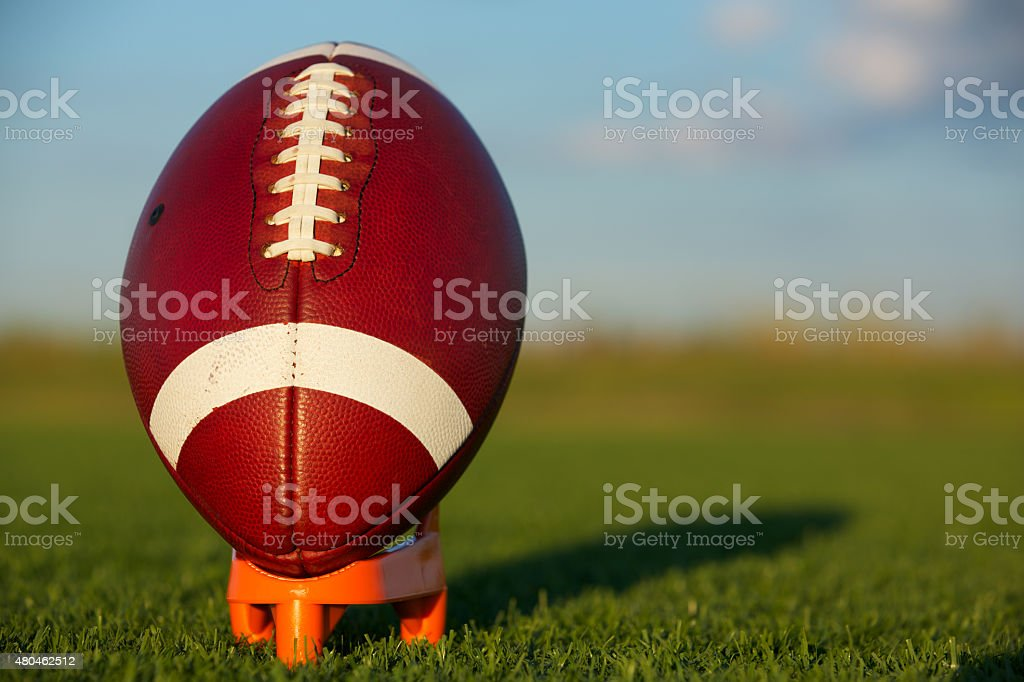 American Football teed up for kickoff stock photo