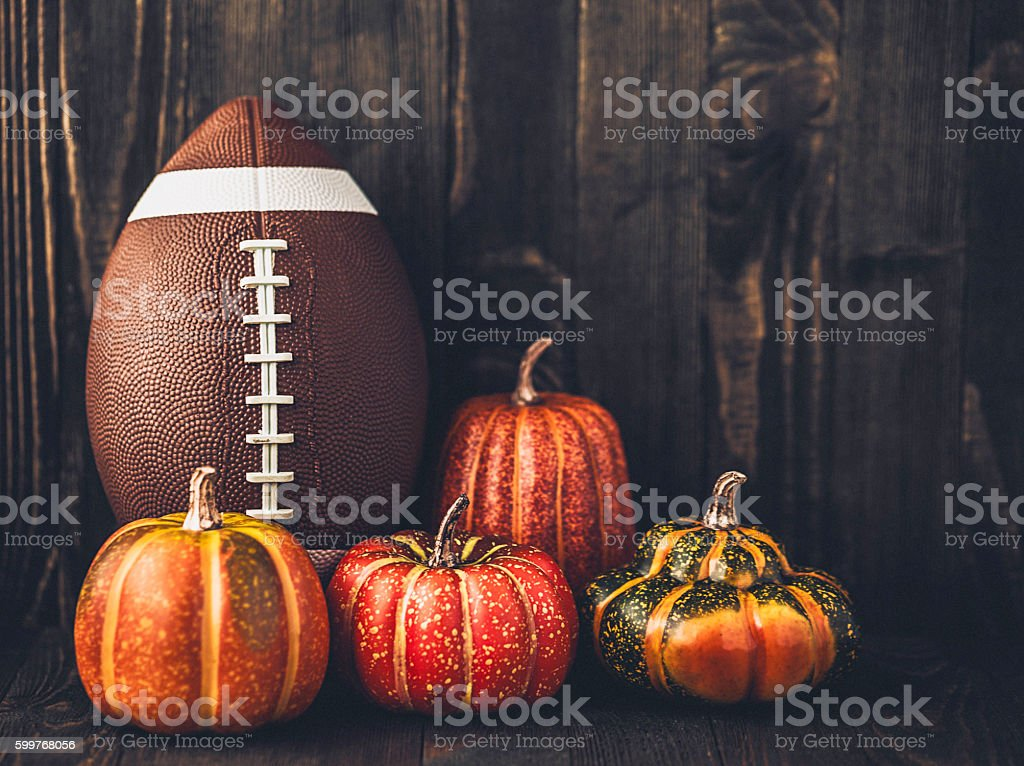 American football with assorted pumpkins stock photo