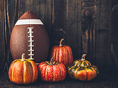 American football with assorted pumpkins