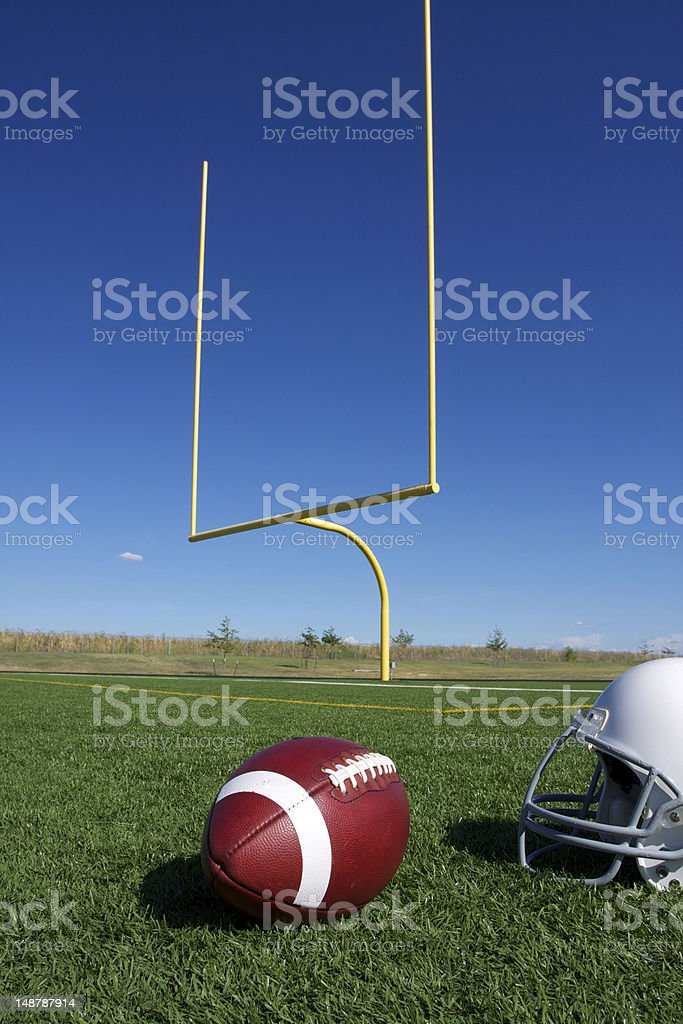 American Football with goal posts stock photo
