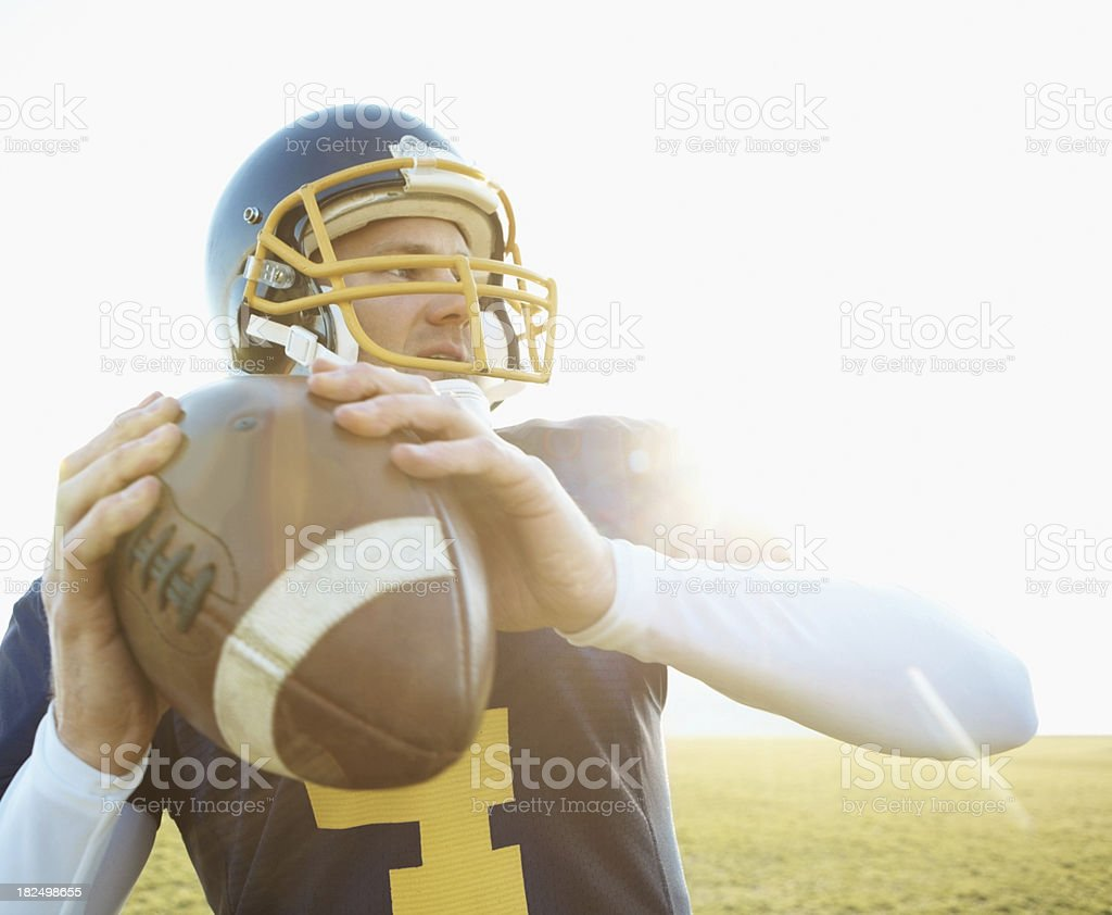 American footballer about to throw the ball stock photo