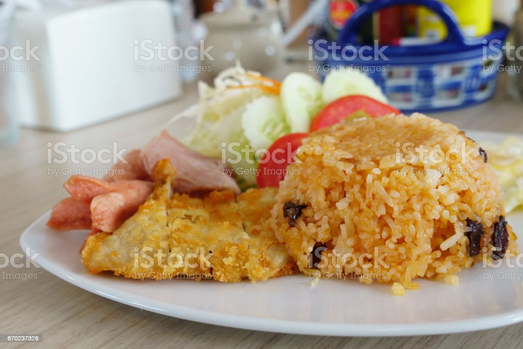 American fried rice , Fried rice with Chicken , sausage , ham and egg. Delicious food in Thailand stock photo