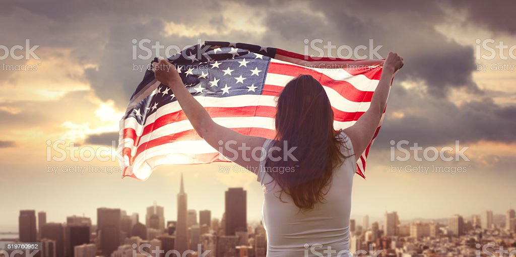 American girl with us flag in San Francisco stock photo