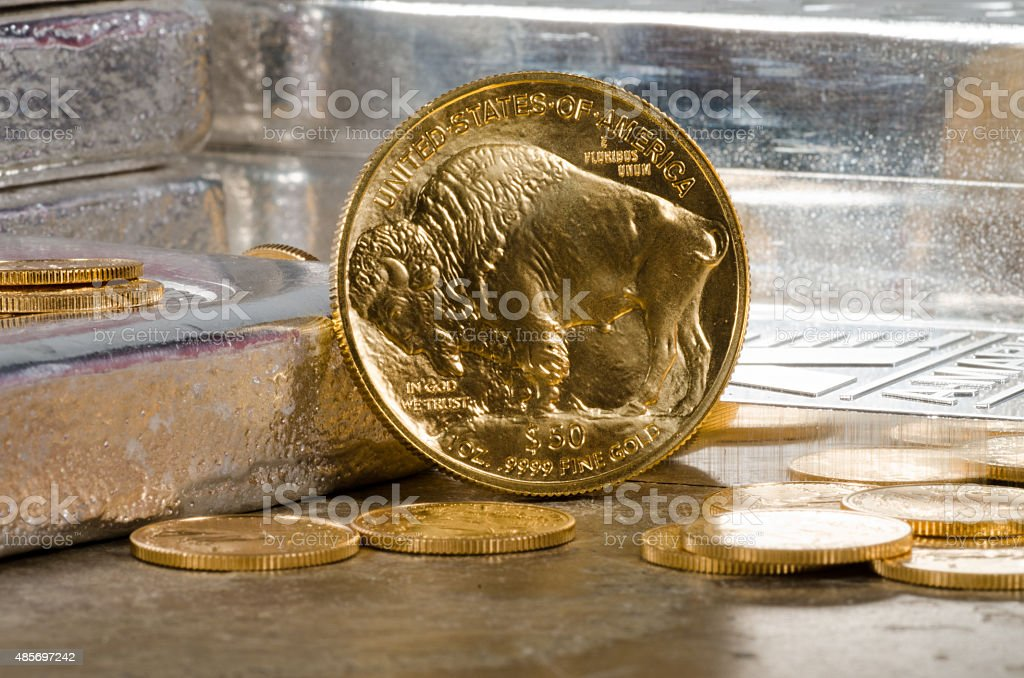 American Gold Buffalo with Silver Bars in the background stock photo
