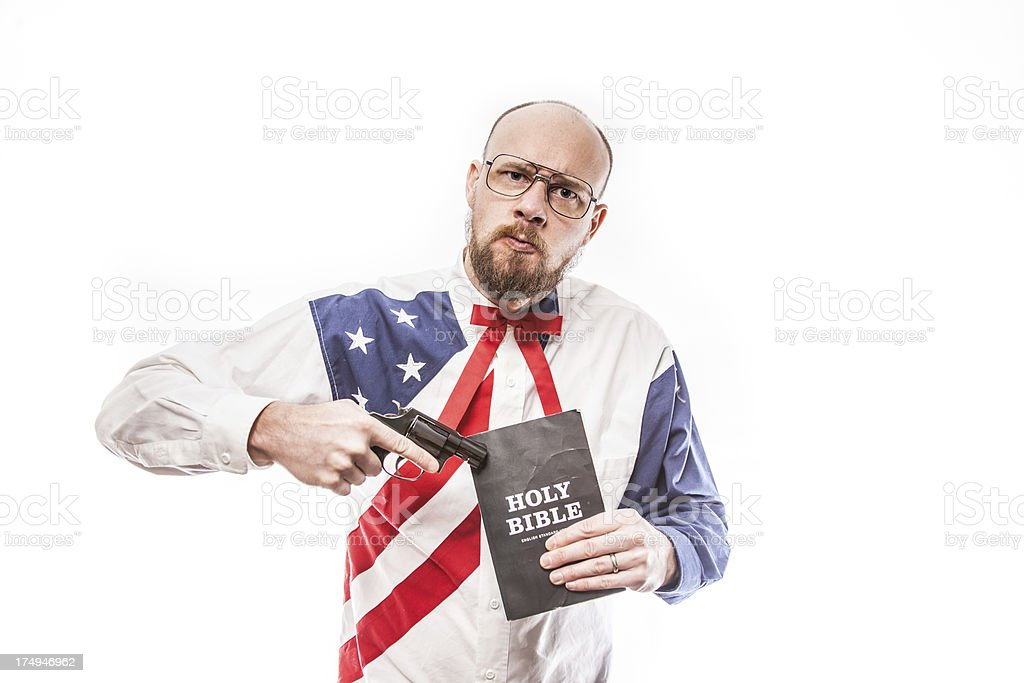 American Holding Gun and Holy Bible royalty-free stock photo