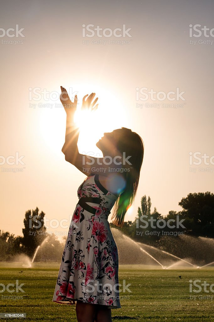 American Indian Girl Holding the Sun stock photo