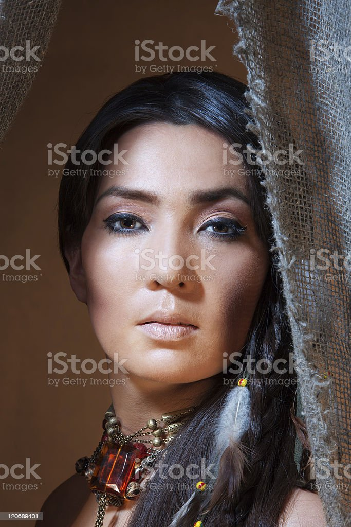 American Indian woman looking from the tent royalty-free stock photo
