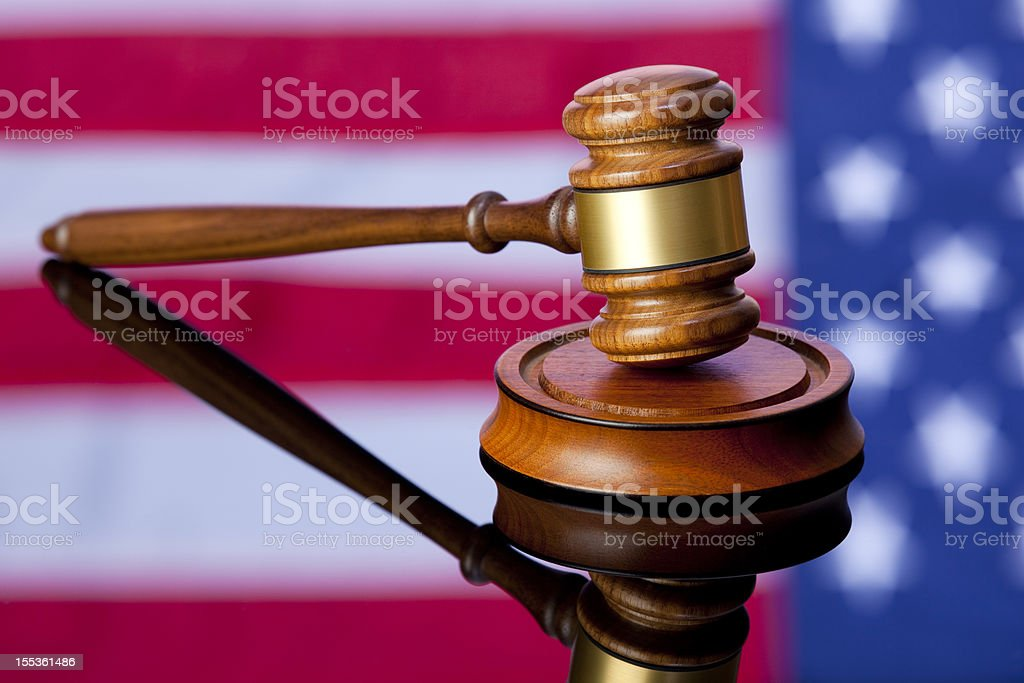 American Justice; Gavel with USA Flag Background stock photo
