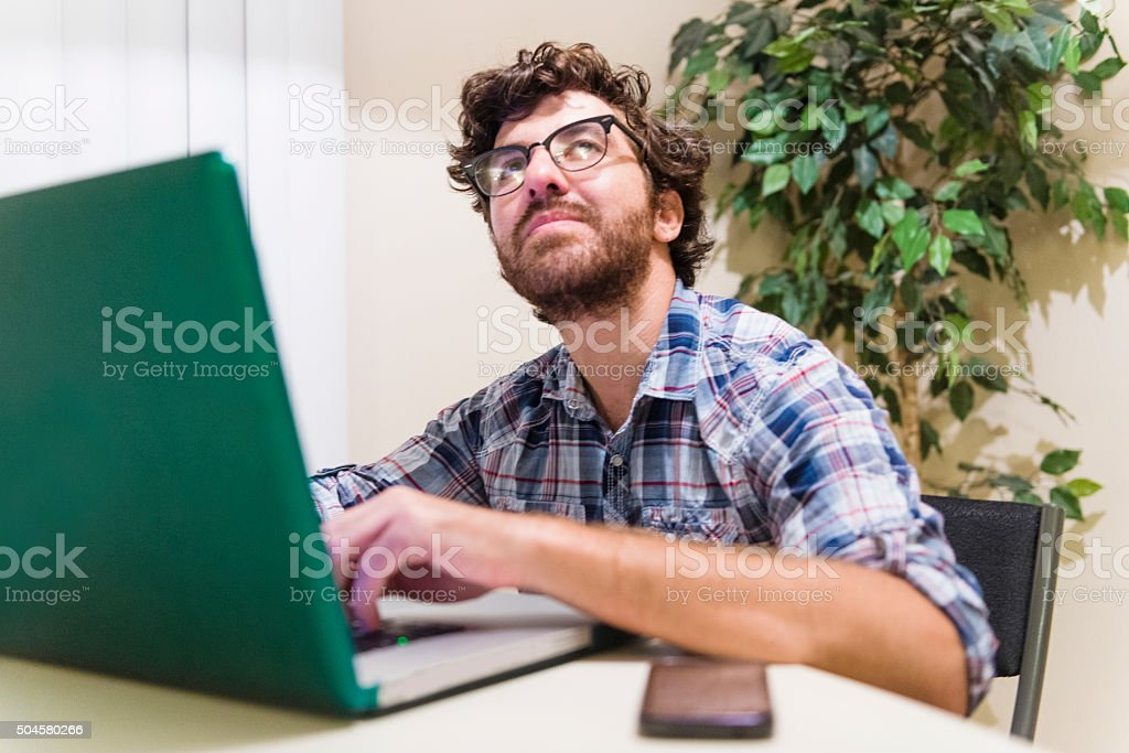 American Man Working Online Takes Break Looking up for Inspiration stock photo