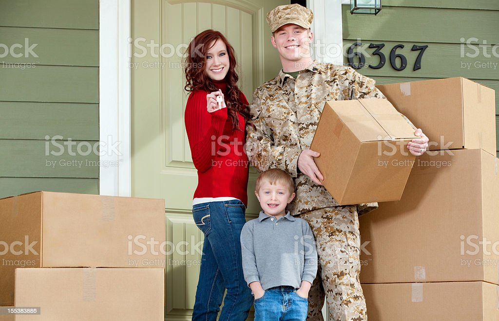 American Marine Corps Soldier & Family Moving into New Home royalty-free stock photo
