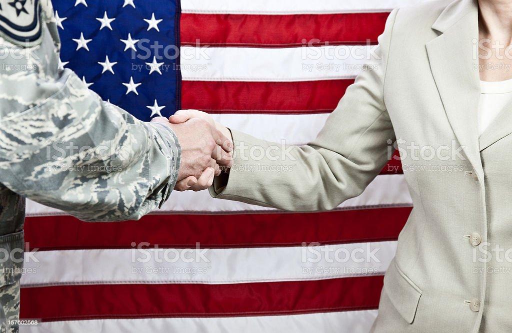 American Military and Civilian Handshake stock photo