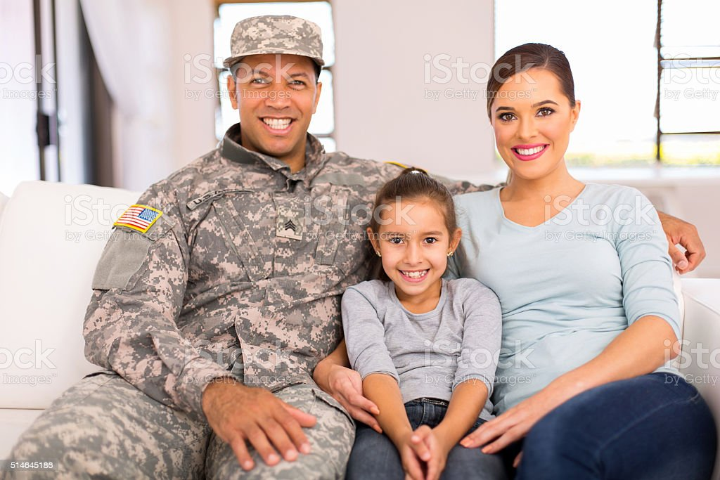 american military family relaxing stock photo
