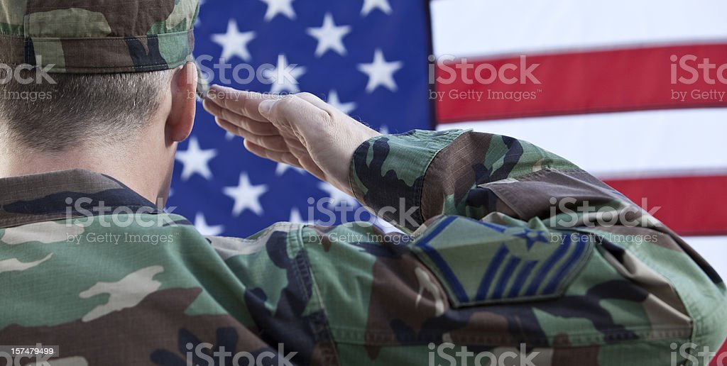 American Military Salute Against US Flag stock photo