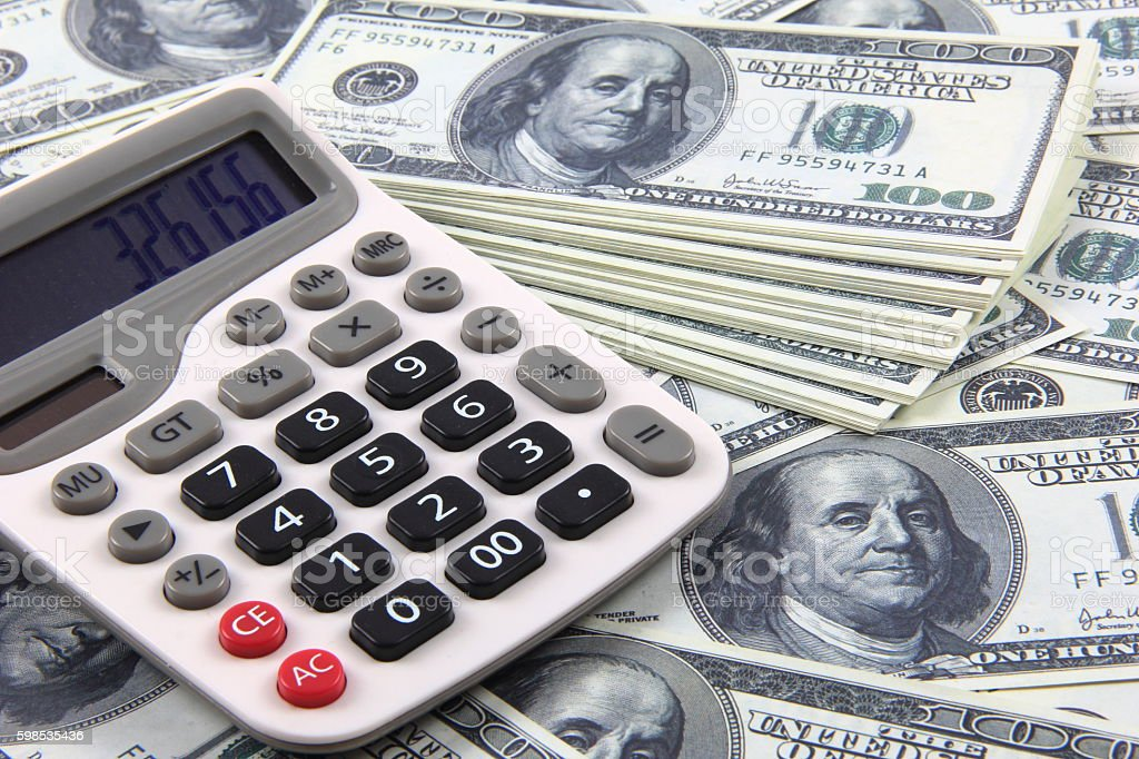 American money and calculator stock photo