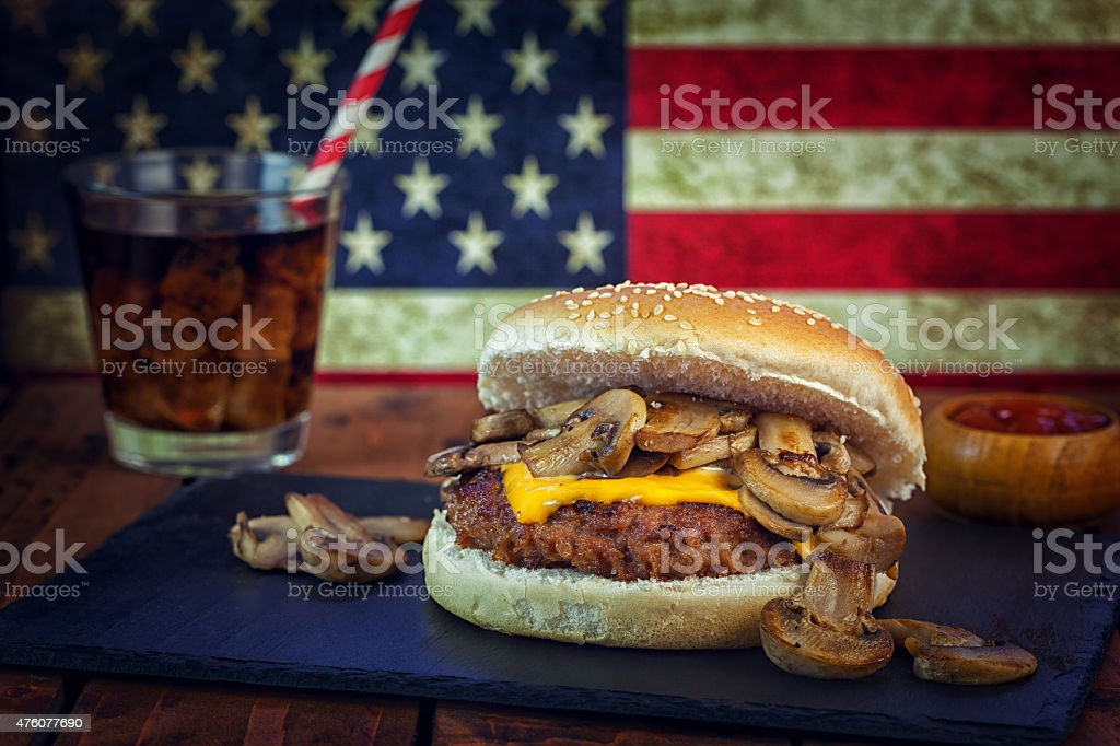 American Mustard-Glazed Mushroom Burger at a 4th of July stock photo