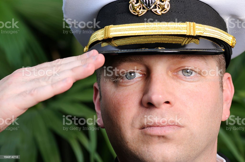American Navy Officer Salutes with Pride & Strength royalty-free stock photo