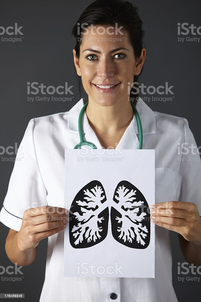 American nurse holding ink drawing of lungs stock photo