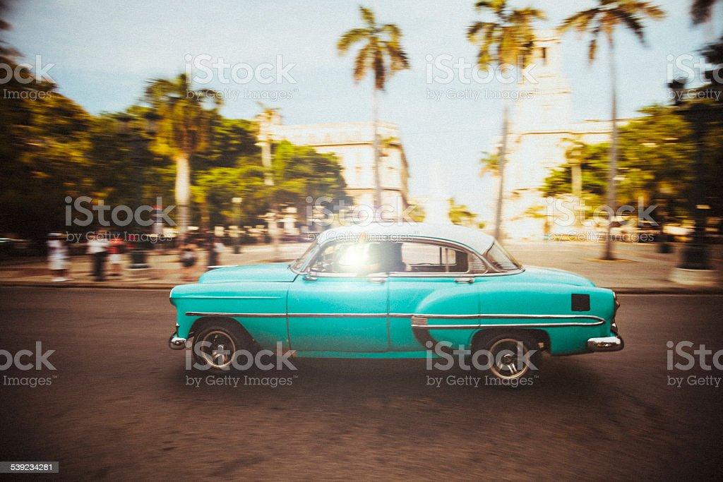 American oldtimer cruises the streets of Havana, Cuba stock photo