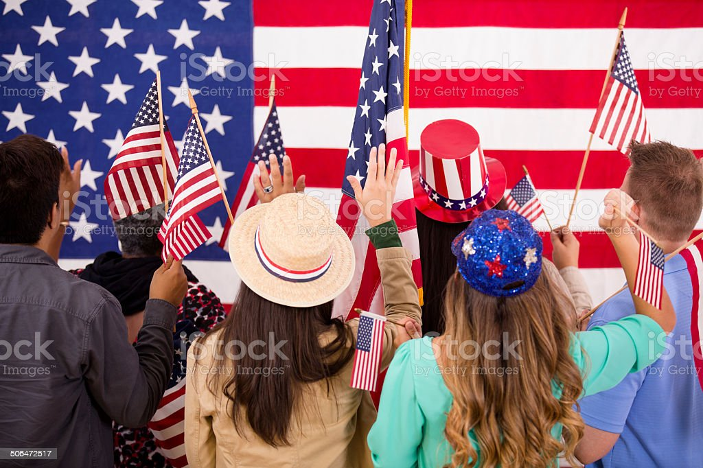American people wave flags at political rally. USA. stock photo