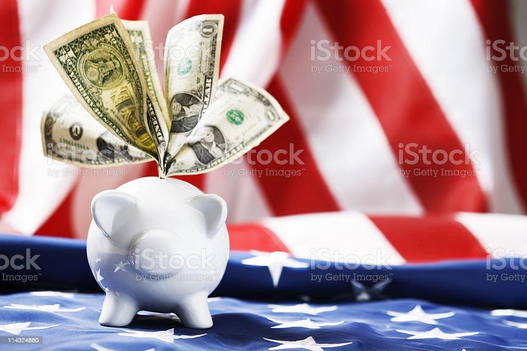 American piggy bank stuffed with dollars stock photo