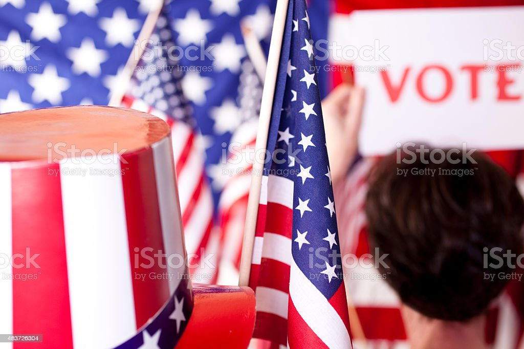 American political rally, elections with VOTE sign and flags. stock photo