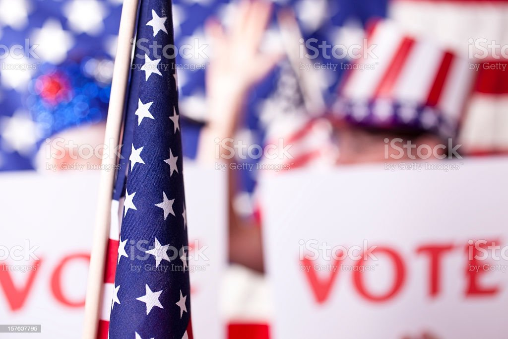 American political rally with VOTE signs stock photo