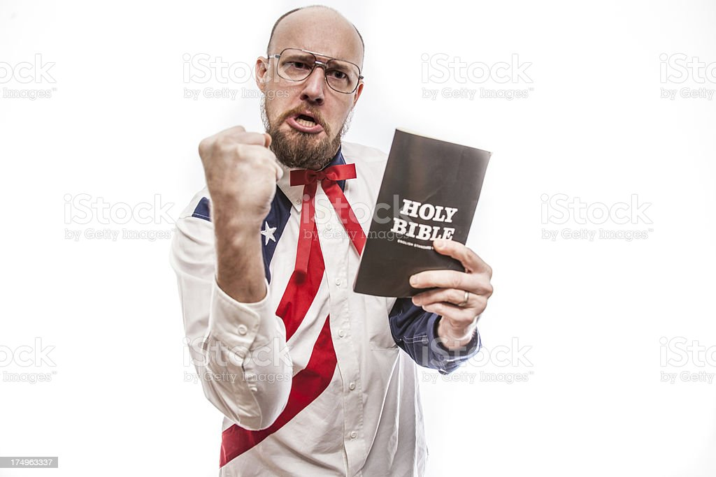 American Preacher Holding Bible with Fist Raised stock photo
