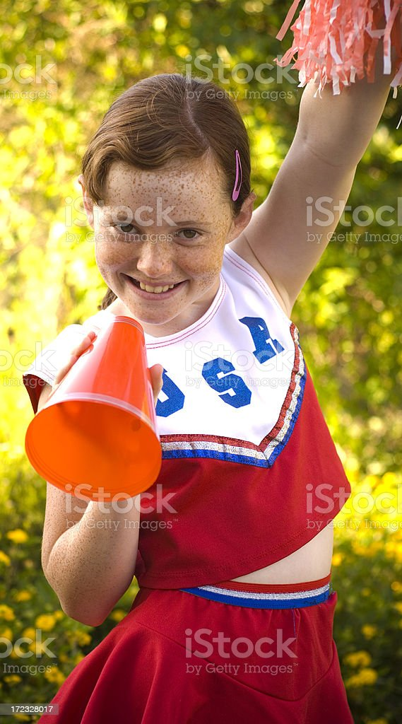 American Pre-Adolescent Redhead & Freckles Girl, Patriotic Child Cheerleader Halloween Costume royalty-free stock photo