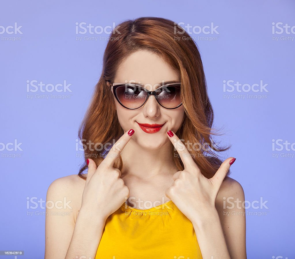 American redhead girl in sunglasses. royalty-free stock photo