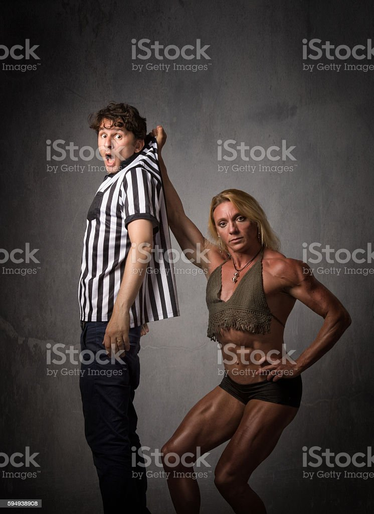 american referee problems with wrestler stock photo