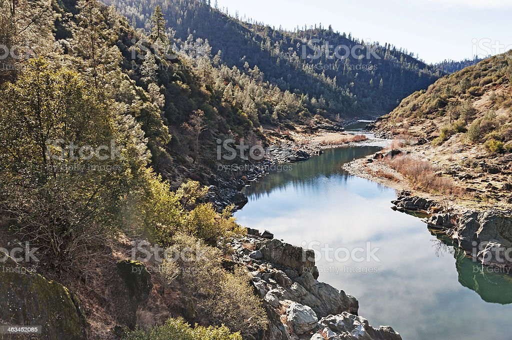 American River flowing between tree covered mountains. stock photo