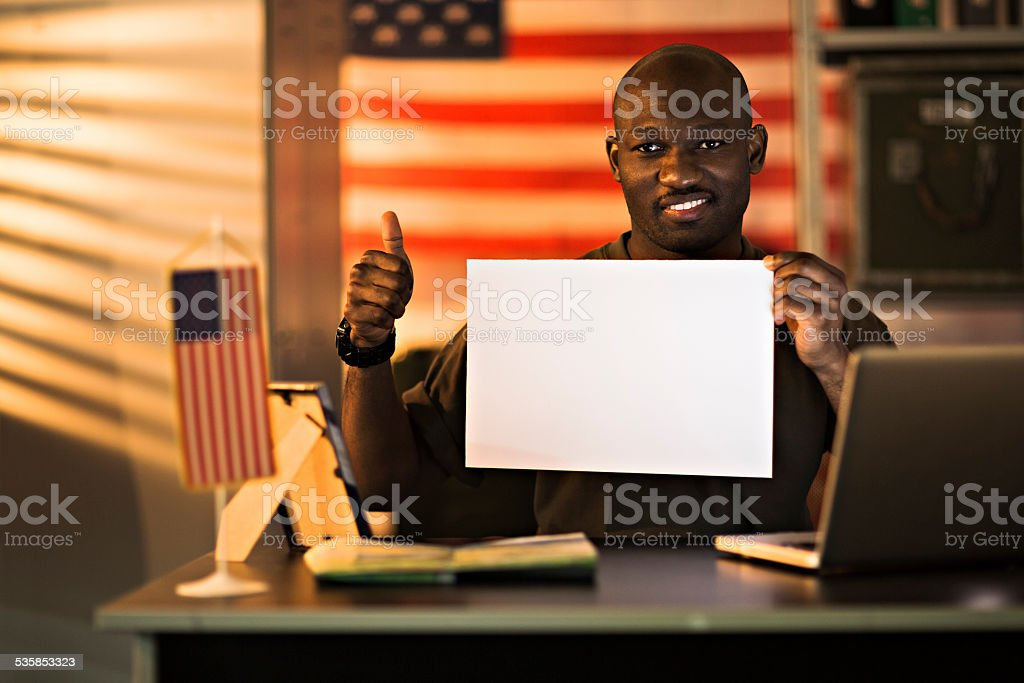 American soldier holding blank poster stock photo