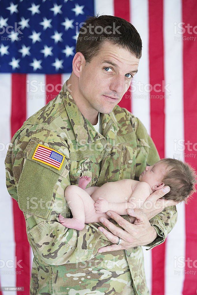 American soldier holding infant baby royalty-free stock photo