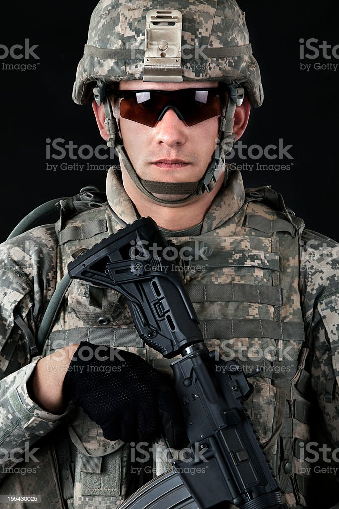 American soldier in combat universal camouflage uniform & helmet & weapon royalty-free stock photo