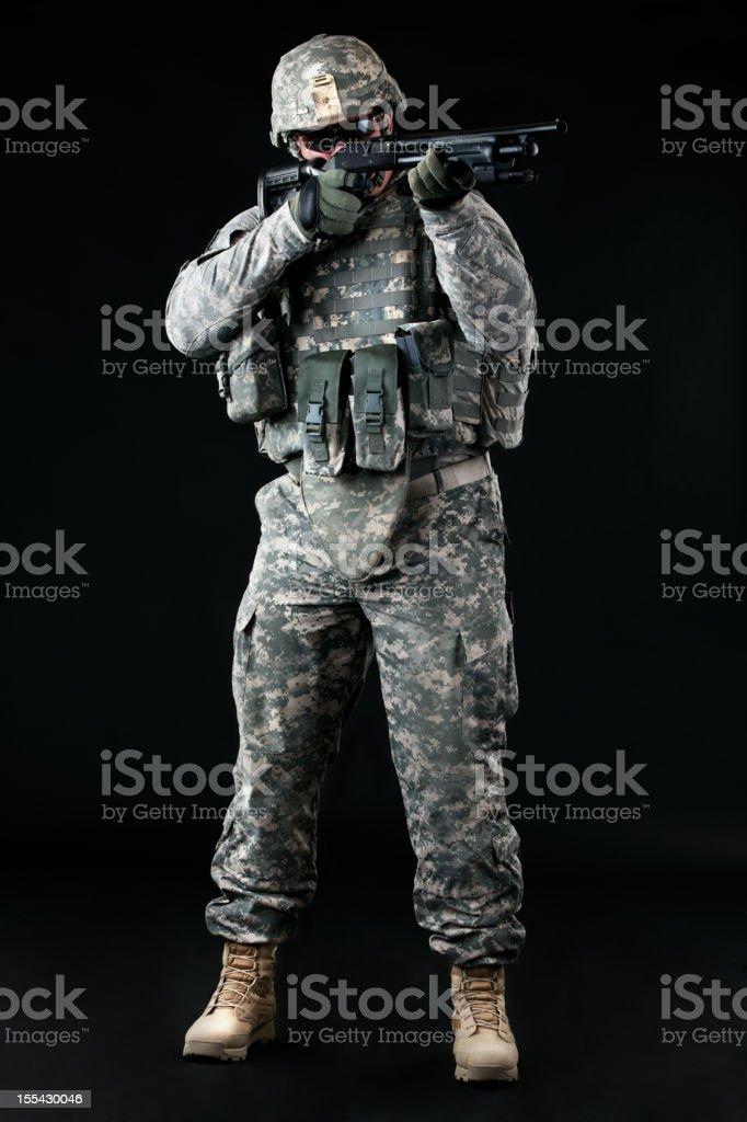 American soldier in combat universal camouflage uniform & weapon royalty-free stock photo