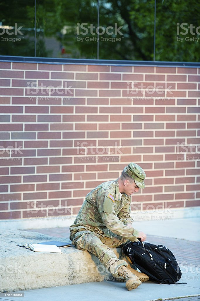 American Soldier looking in his backpack royalty-free stock photo