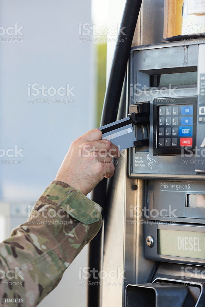 American soldier paying for gas royalty-free stock photo