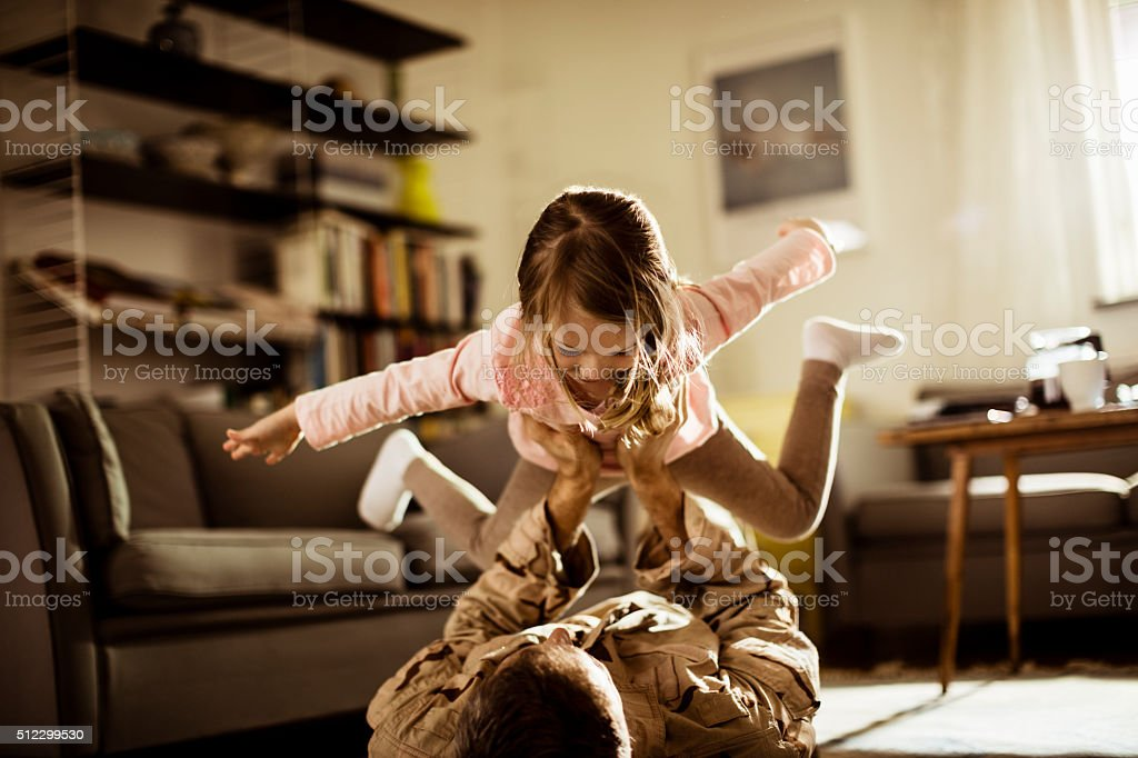 American soldier playing with his daughter stock photo