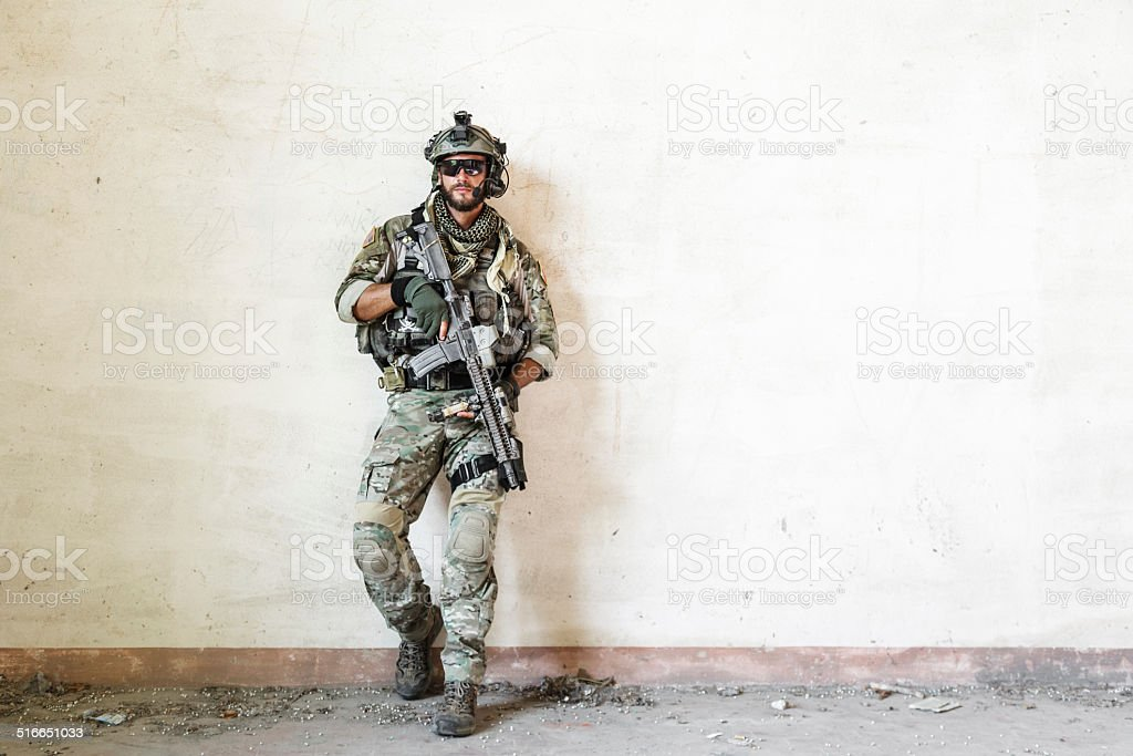 american soldier poses during military operation stock photo