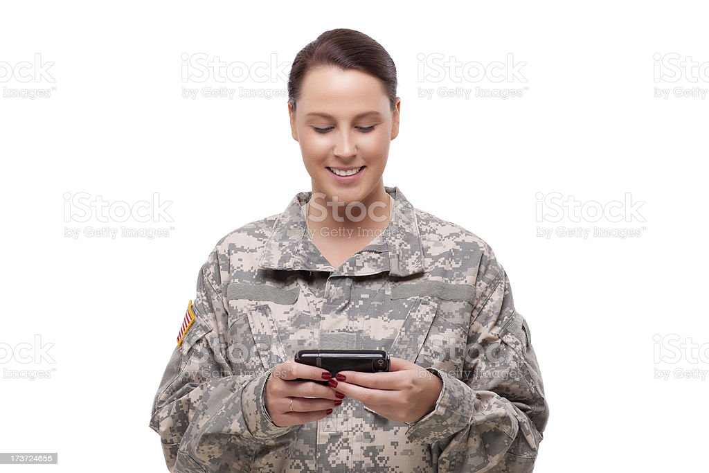 American soldier reading a text message royalty-free stock photo