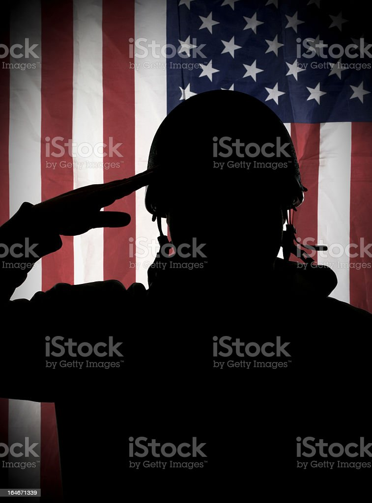 American (USA) soldier saluting to USA flag stock photo