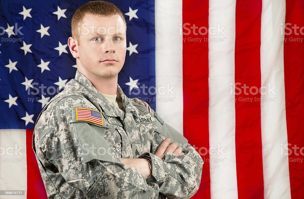 American Soldier Series: Young Sergeant Standing against USA Flag royalty-free stock photo