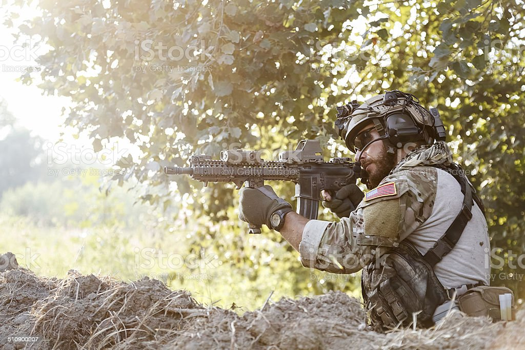 american soldier shooting stock photo