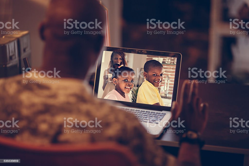 American soldier talking to his family stock photo