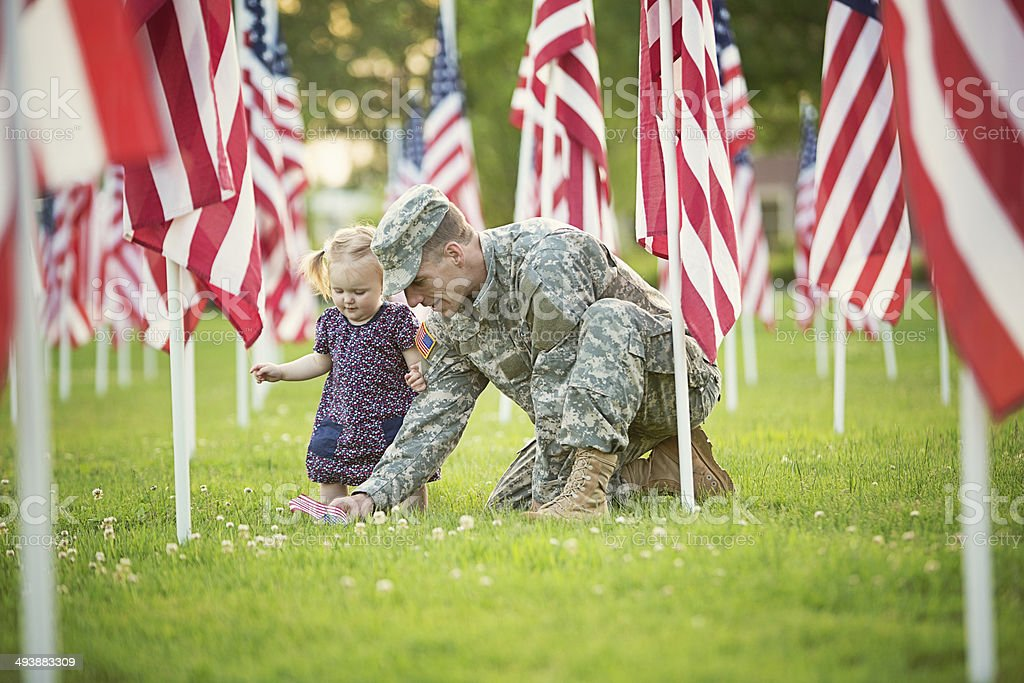 American soldier with daughter stock photo