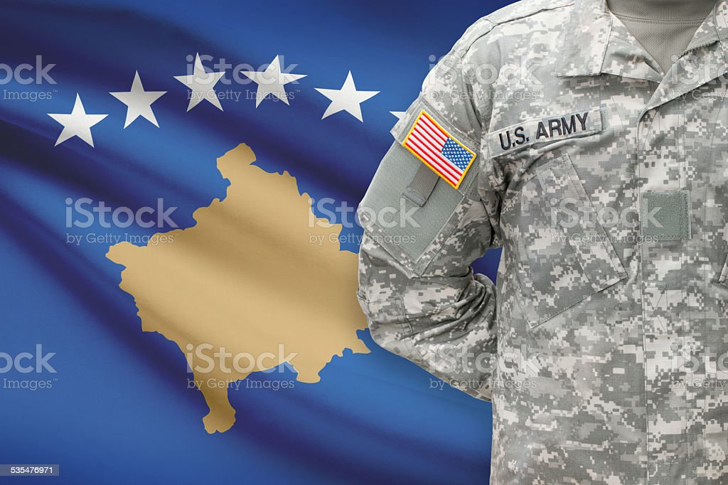 American soldier with flag on background - Kosovo stock photo