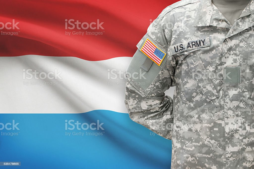 American soldier with flag on background - Luxembourg stock photo