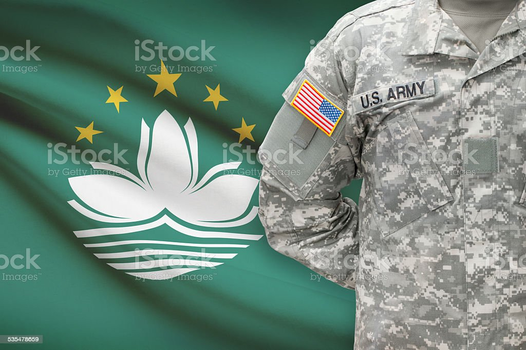 American soldier with flag on background - Macau stock photo